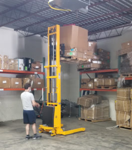 ldr employee uses pallet stacker to store pallets of fba inventory